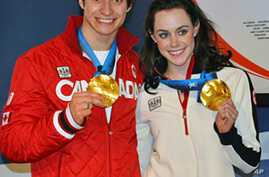 Canadian ice dancers Scott Moir and Tessa Virtue with their gold medals