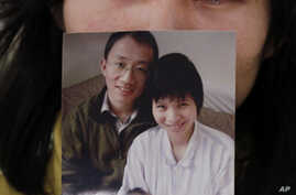 Wife of Chinese Dissident Sees Husband Before Release