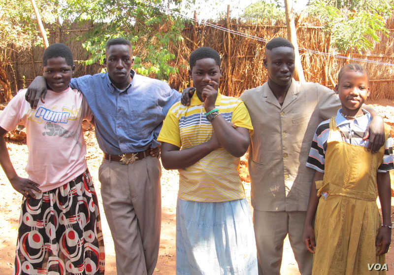 Photo of 5 people who escaped the LRA and escaped to a Safe Reporting Site in Central African Republic in November 2012. U.S. military advisers worked with local officials and community leaders to set up the site, where former LRA combatants and form