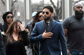 Empire actor Jussie Smollett, center, arrives at the Leighton Criminal Court Building for his hearing on  March 14, 2019, in Chicago.