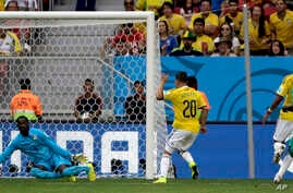 Colombia's Juan Quintero (20)  scores his side's second goal during the group C World Cup soccer match between Colombia and Ivory Coast at the Estadio Nacional in Brasilia, Brazil, June 19, 2014.