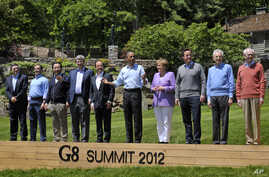 World leaders attend the family photo session during the G-8 Summit at Camp David, Maryland, May 19, 2012.