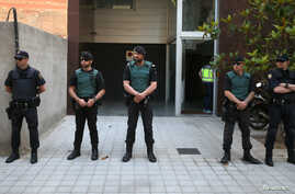 FILE - Spanish police officers.