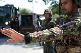 Afghan National Army soldiers search vehicles at a checkpoint in the city of Jalalabad on Aug. 1, 2018. Afghanistan ramped up security in Jalalabad on August 1, a day after militants stormed a government office.