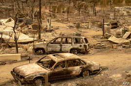 This photo shows cars burned in the Ranch Fire, part of the Mendocino Complex Fire, in Spring Valley near Clearlake Oaks, northern California, Aug. 7, 2018.