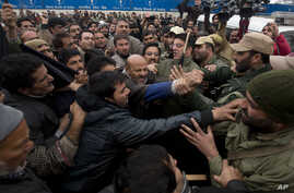 Activists of the Awami Ittihad party get into a scuffle with Indian policemen as they are stopped during a protest to mark International Human Rights Day in Srinagar, India, Dec. 10, 2015.