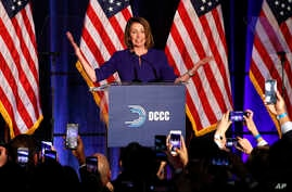 House Minority Leader Nancy Pelosi of Calif., smiles as she is cheered by a crowd of Democratic supporters during an election night returns event at the Hyatt Regency Hotel, on Nov. 6, 2018, in Washington.
