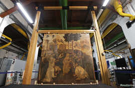 """The """"Adoration of the Magi"""", a massive painting that Leonardo da Vinci started in 1481 at the age of 29 but abandoned a year later, leaving it in various stages of conception and development, is unveiled in Florence September 23, 2014."""