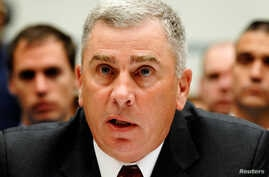 FILE: Retired U.S. Army Gen. John Abizaid testifies during a House Oversight and Government Reform Committee hearing on what military leaders knew about the death in Afghanistan of  Army Ranger and ex-football star Pat Tillman,  Aug. 1, 2007.