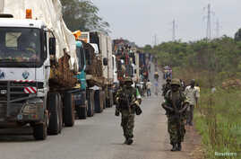 African Union (AU) peacekeepers guard a commercial convoy making its way to the border of Cameroon, near Bangui, March 8, 2014.