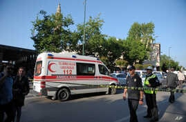 Police officers secure the area after a suicide bomb explosion outside the historical Ulu Cami in Bursa, Turkey, Wednesday, April 27, 2016.