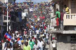 Protesters chant anti-government slogans during a protest against President Michele Martelly's government to demand the cancellation of the Jan. 24, elections, in Port-au-Prince, Haiti, Jan. 18, 2016.