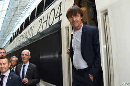 French Minister of Ecological and Inclusive Transition Nicolas Hulot steps off a train next to the head of the French national state-owned railway company SNCF, Guillaume Pepy), during the inauguration of a new TGV high-speed train line linking Paris