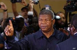 Angola's MPLA main ruling party candidate and defense minister, Joao Lourenco, shows his ink-stained finger after casting his vote in Luanda, Angola, Aug. 23, 2017. Lourenco is the front-runner to succeed President Jose Eduardo dos Santos, who will s