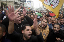 Palestinian mourners carry the body of Ibrahim Skafi, 22, during his funeral in the West Bank city of Hebron, Thursday, Nov. 5, 2015. President Obama will host Israeli Prime Minister Benjamin Netanyahu at the White House on Monday.