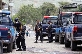 Members of Nicaragua's Special Forces patrol the streets after clashes with anti-government protesters in the Sandino neighborhood in Jinotepe, Nicaragua, July 24, 2018.