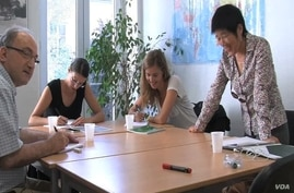 Instructor Meifen Chen teaches Mandarin Chinese to a class of language students in Paris, August 2012.