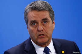 Roberto Azevedo, Director-General of the World Trade Organization (WTO), attends a news conference with representatives of the trade organizations after a meeting in the chancellery in Berlin, Germany, June 11, 2018.