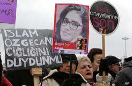 """A Turkish woman holds a poster of 20-year old student Ozgecan Aslan, whose body was found Friday in Mersin, southern Turkey, at a protest in Ankara Feb. 18, 2015. The placards read: """"End the killings of women"""" and """"Islam (Aysenur Islam, Family Affiar"""