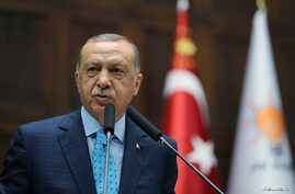 Turkish President Tayyip Erdogan addresses parliamentarians from his ruling AK Party during a meeting at the parliament in Ankara, Turkey, July 24, 2018.