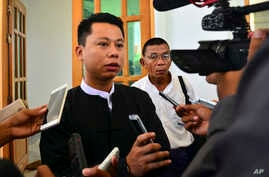 Arnt Khaung Min, deputy chief editor of the weekly Myanmar Herald, speaks to journalists as he leaves a township court in Naypyitaw, Myanmar, July 21, 2015.