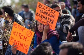 An Indian student holds a placard demanding the release of student leader Kanhaiya Kumar during a protest at the Jawaharlal Nehru University in New Delhi, India, Tuesday, Feb. 16, 2016.