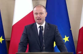 Malta's Prime Minister Joseph Muscat gives a statement announcing the arrest of suspects in the October 16 killing of journalist Daphne Caruana Galizia, in Valletta, Malta, Dec.4, 2017. In all, 10 people were arrested; three were charged Dec. 5.