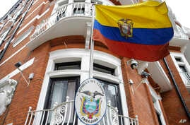The Ecuadorian national flag flies outside their London Embassy, Tuesday, Oct. 18, 2016.