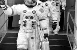 The crew of the Apollo 13 lunar landing mission are shown in their space suits on their way to the launch pad at Kennedy Space Center in Cape Kennedy, Fla., Saturday, April 11, 1970.