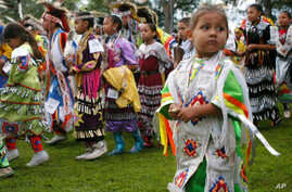 FILE: Bobby Morris, 4, of Wisconsin Dells, Wis., joins hundreds of other dancers at the Prairie Island Dakota Wacipi Celebration Pow Wow hosted by the Prairie Island Indian Community near Red Wing., Minn., on July 11, 2003.