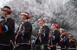 Tibetans play their traditional musical instruments to commemorate Serf Liberation Day in Nyingchi Prefecture, Tibet Autonomous Region, March 27, 2014.