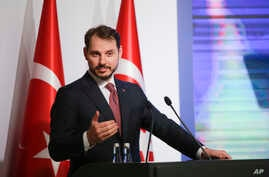 Berat Albayrak, Turkey's Treasury and Finance Minister, talks during a conference in Istanbul,  Aug. 10, 2018, in a bid to ease investor concerns about Turkey's economic policy.