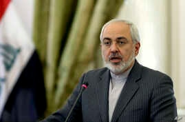 Iranian Foreign Minister Mohammad Javad Zarif speaks in a joint press conference with his Iraqi counterpart Hoshyar Zebari, in Tehran, Feb. 26, 2014.