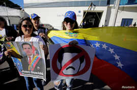 Venezuelans living in Honduras hold a protest against Venezuelan President Nicolas Maduro's government in Tegucigalpa, Honduras, Jan. 23, 2019.