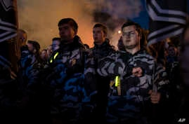FILE - Members of nationalist movements attend a rally marking Defender of Ukraine Day, in Kyiv, Ukraine, Oct. 14, 2018.