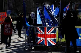 Pro and Anti Brexit protesters demonstrate outside the Houses of Parliament in London, Jan. 28, 2019.