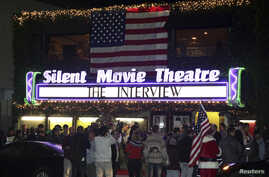 "Fans line up at the Silent Movie Theatre for a midnight screening of ""The Interview"" in Los Angeles, California, Dec. 24, 2014."