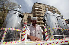 Waleed Ahmed el-Sayed, 31, who received a BA in social services from Assyiut University in 2004, sells juice in Tahrir square in Cairo May 4, 2012. Waleed has been working as a street vendor for almost seven years as he has not found a steady job sin