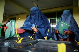 Afghan women cast ballots at local polling station, Kabul, April 5, 2014.