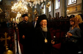 Ecumenical Patriarch Bartholomew I, the spiritual leader of the world's Orthodox Christians, leaves the Patriarchal Church of St. George, following Sunday services in Istanbul, Oct. 7, 2018.
