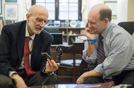 FILE - Former Cuba detainee Alan Gross, left — shown visit