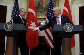 President Donald Trump reaches to shake hands with Turkish President Recep Tayyip Erdogan in the Roosevelt Room of the White House in Washington, May 16, 2017, where they made statements.