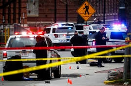 FILE - In this Nov. 28, 2016 file photo, crime scene investigators collect evidence from the pavement as police respond to an attack on campus at Ohio State University, in Columbus, Ohio.