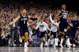 Villanova's Jalen Brunson (1), Mikal Bridges (25) and their teammates celebrate after the NCAA Final Four tournament college basketball championship game against North Carolina, Monday, April 4, 2016.