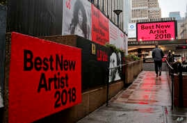 Signs posted around Madison Square Garden promote the return of the Grammy Awards to New York, Jan. 23, 2018, in New York. The Grammy Awards will be held on Sunday.