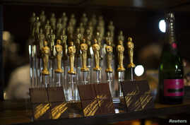 FILE - Oscar-shaped chocolates are pictured at a preview of the food and decor for the 87th Academy Awards' Governors Ball at the Ray Dolby ballroom in Hollywood, Calif., February 4, 2015. One marketing firm has promised $200,000 gift bags for celebr