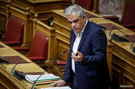 FILE - Civil Protection Minister Nikos Toskas delivers a speech during a parliament session in Athens, Greece, June 21, 2018.