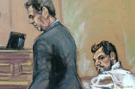 Mehmet Hakan Atilla, right, who works for Halkbank in Turkey, is shown in this court room sketch with his attorney Gerald J. DiChiara as he appears in Manhattan federal court in New York, March 28, 2017.