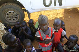 Children of displaced families are seen camped inside Tomping U.N. base near Juba international airport December 24, 2013.