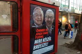 "A phone box displays a billboards showing Hungarian-American financier George Soros and EU Commission President Jean-Claude Juncker above the caption ""You have a right to know what Brussels is preparing to do!,"" on Vaci Avenue in Budapest, Hungary,..."